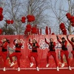 """Dancers perform to """"Gangnam Style"""" during the temple fair in Ditan Park, also known as the Temple of Earth, in Beijing"""
