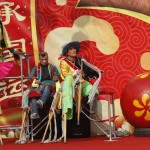 Folk artists take off their stilts after their performance at Longtan Park in Beijing