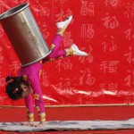 A girl performs an acrobatic show during the temple fair in Ditan Park in Beijing