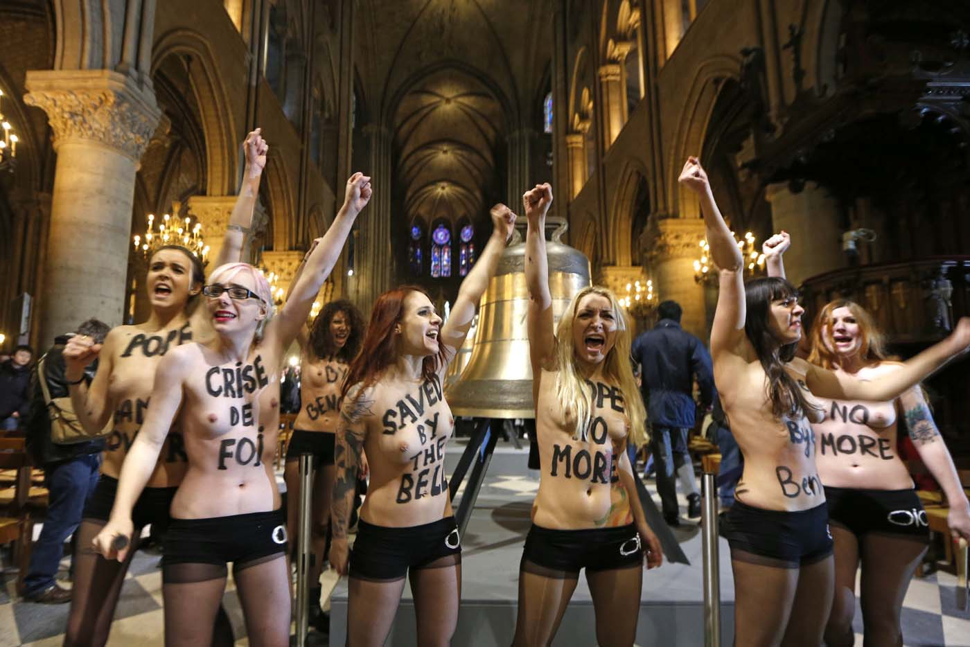 Activists from the women's rights organisation Femen protest in front of the new eight bronze bells of Notre-Dame de Paris Cathedral in Paris