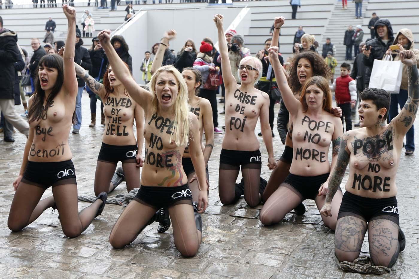 Activists from the women's rights organisation Femen shout slogans outside Notre-Dame de Paris Cathedral  in Paris