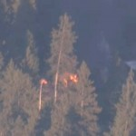 KNBC4 TV aerial image shows smoke and fire from a cabin where fugitive former Los Angeles police officer Christopher Dorner is believed to be barricaded