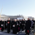 Cardinals with bishops and priests walks in front of St. Peter Basilica before Pope Benedict XVI's special audience with priests of the Diocese of Rome in Paul VI's hall at the Vatican