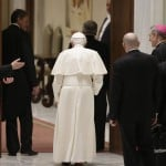 Pope Benedict XVI leaves at the end of a special audience with priests of the Diocese of Rome in Paul VI's hall at the Vatican