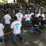 Venezuelan students chain themselves together as they take part in a demonstration near the Cuban embassy in Caracas