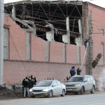 Workers repair damage caused after a meteorite passed above the Urals city of Chelyabinsk