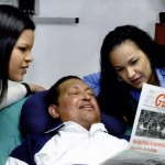 Venezuela's President Hugo Chavez holds a copy of the newspapers while recovering from cancer surgery in Havana