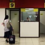 Cuba's best-known dissident, blogger Yoani Sanchez, walks towards the emigration control at Havana's Jose Marti International Airport