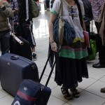 Cuba's best-known dissident, blogger Yoani Sanchez, waits to check in for her flight to Brazil at Havana's Jose Marti International Airport