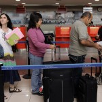 Cuba's best-known dissident, blogger Yoani Sanchez, queues to check in for her flight to Brazil at Havana's Jose Marti International Airport