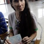 Cuba's best-known dissident, blogger Yoani Sanchez, displays her visa for the U.S. at Havana's Jose Marti International Airport