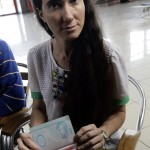 Cuba's best-known dissident, blogger Yoani Sanchez, displays her visa for the U.S. at Havana's Jose Marti International Airport