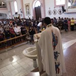 Catholic priest Alvarez officiates mass while wearing a robe with the images of cartoon characters Superman and Batman at the Ojo de Agua church in Saltillo