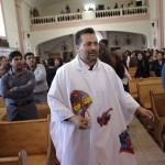 Catholic priest Alvarez wears a robe with the images of cartoon character Spiderman as he walks among the faithful during a mass for the congregation at the Ojo de Agua church in Saltillo