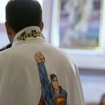Catholic priest Alvarez officiates mass while wearing a robe with images of cartoon characters Superman and Batman at the Ojo de Agua church in Saltillo