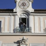 Workers paint the window of the main balcony at the summer residence of Pope Benedict XVI in Castel Gandolfo