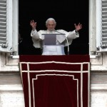 Pope Benedict XVI waves as he leads his last Sunday Angelus prayer before stepping down in Saint Peter's Square at the Vatican