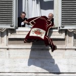 Pope Benedict XVI's personal secretary Georg Gaenswein prepares the tapestry for the last Angelus prayer before Pope Benedict steps down in Saint Peter's Square at the Vatican