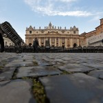 A worker carries chairs to prepare for the weekly audience of Pope Benedict XVI in Saint Peter's Square at the Vatican