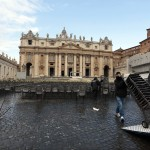 A worker transports chairs to prepare for the weekly audience of Pope Benedict XVI in Saint Peter's Square at the Vatican