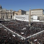 Pope Benedict XVI rides his Popemobile through a packed Saint Peter's Square at the Vatican during his last general audience