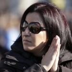 A woman waits in a packed Saint Peter's Square where Pope Benedict XVI holds his last general audience, at the Vatican