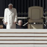 Pope Benedict XVI arrives to take his seat in St Peter's Square to hold his last general audience at the Vatican