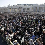 The crowd listens to Pope Benedict XVI in St Peter's Square during his last general audience at the Vatican