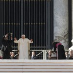 Pope Benedict XVI waves to the faithful after holding his last general audience at the Vatican