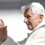 Pope Benedict XVI waves to the faithful as he arrives in St Peter's Square to hold his last general audience at the Vatican