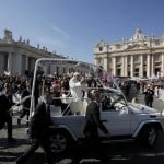 Pope Benedict XVI waves to the faithful after arriving in St Peter's Square to hold his last general audience at the Vatican