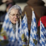 A woman waits in St Peter's Square before Pope Benedict XVI's last general audience at the Vatican