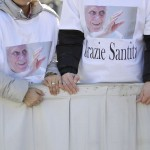 """People wearing t-shirts reading """"Thank you, your Holiness"""" wait in St Peter's Square before Pope Benedict XVI holds his last general audience at the Vatican"""
