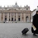 A priest walks in Saint Peter's square at the Vatican