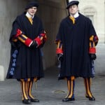 Swiss Guards stands at the entrance of the Vatican