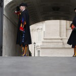 Swiss Guards stand at the entrance of the Vatican