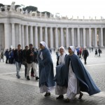Nuns walk in Saint Peter's Square at the Vatican