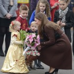 Britain's Catherine, Duchess of Cambridge receives flowers from children during a visit to Peak Lane fire station in Grimsby