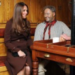 Britain's Catherine, Duchess of Cambridge sits next to a dummy of the Ship's Mate on the Skipper's Table, on display at the National Fishing Heritage Centre, in Grimsby