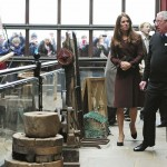 Britain's Catherine, Duchess of Cambridge speaks with former trawler-man during her tour of the National Fishing Heritage Centre in Grimsby, northern England