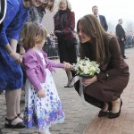 Britain's Catherine, Duchess of Cambridge receives flowers from three-year-old Lucy Bell during her visit to the National Fishing Heritage Centre in Grimsby, northern England