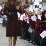 Britain's Catherine, the Duchess of Cambridge waves to children during a visit to the Havelock Academy in Grimsby