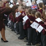 Britain's Catherine, the Duchess of Cambridge speaks to children during a visit to the Havelock Academy in Grimsby