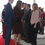 Britain's Catherine, Duchess of Cambridge speaks with a pregnant woman during a visit to the Havelock Academy in Grimsby