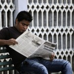 A man reads a newspaper in Havana
