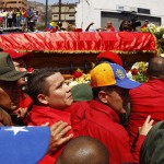 The coffin of deceased Venezuelan leader Hugo Chavez is driven through the streets of Caracas after leaving the military hospital where he died of cancer, in Caracas