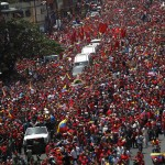 The coffin of Venezuela's late President Hugo Chavez is driven through the streets of Caracas after leaving the military hospital where he died of cancer in Caracas