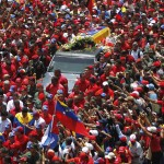 The coffin of Venezuela's late President Hugo Chavez is driven through the streets of Caracas after leaving the military hospital where he died of cancer, in Caracas