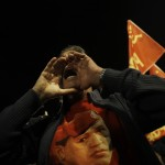 A man wearing a T-shirt with an image of the late Venezuelan President Hugo Chavez shouts slogans during a rally paying homage to him in Madrid