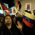 People attend a rally to pay homage to the late Venezuelan President Hugo Chavez in Madrid